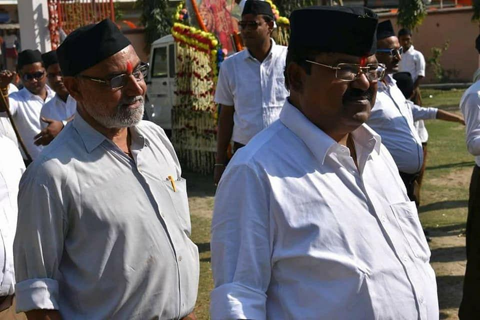 A older picture of LJP candidate from Kadwa Chandra Bhushan Thakur (Left) at an RSS function