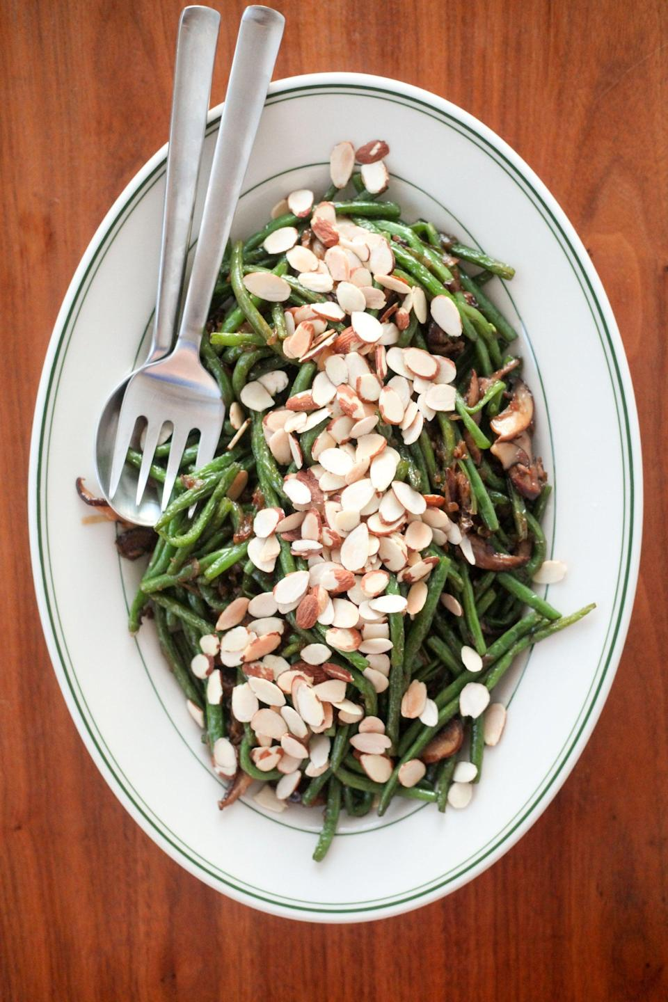 "<p>Caramelized onions, sautéed mushrooms, a splash of sherry vinegar, and a toasted almond topping give unexpected flavor and texture to these simple blistered green beans. Make these for an easy, dairy-free green you can feel good about eating. </p> <p><strong>Get the recipe:</strong> <a href=""https://www.popsugar.com/food/Blistered-Green-Beans-Mushrooms-Caramelized-Onions-42635901"" class=""link rapid-noclick-resp"" rel=""nofollow noopener"" target=""_blank"" data-ylk=""slk:blistered green beans with mushrooms and caramelized onions"">blistered green beans with mushrooms and caramelized onions</a></p>"