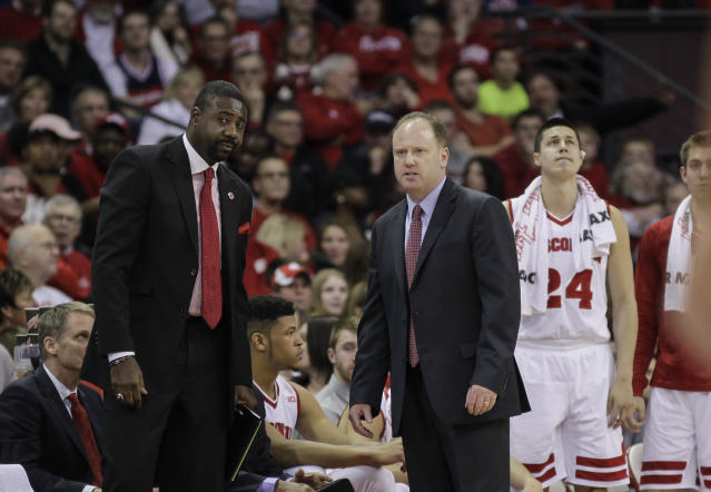 Wisconsin interim Greg Gard, center, and new assistant coach Howard Moore, left, during the first half of an NCAA college basketball game against Green Bay Wednesday, Dec. 23, 2015, in Madison, Wis. (AP Photo/Andy Manis)