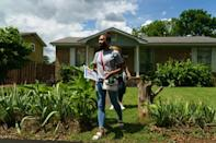 Volunteers walk door-to-door on June 30, 2021 to inform residents about a Covid-19 vaccination event in Birmingham, Alabama; the US South has some of the country's lowest vaccination rates