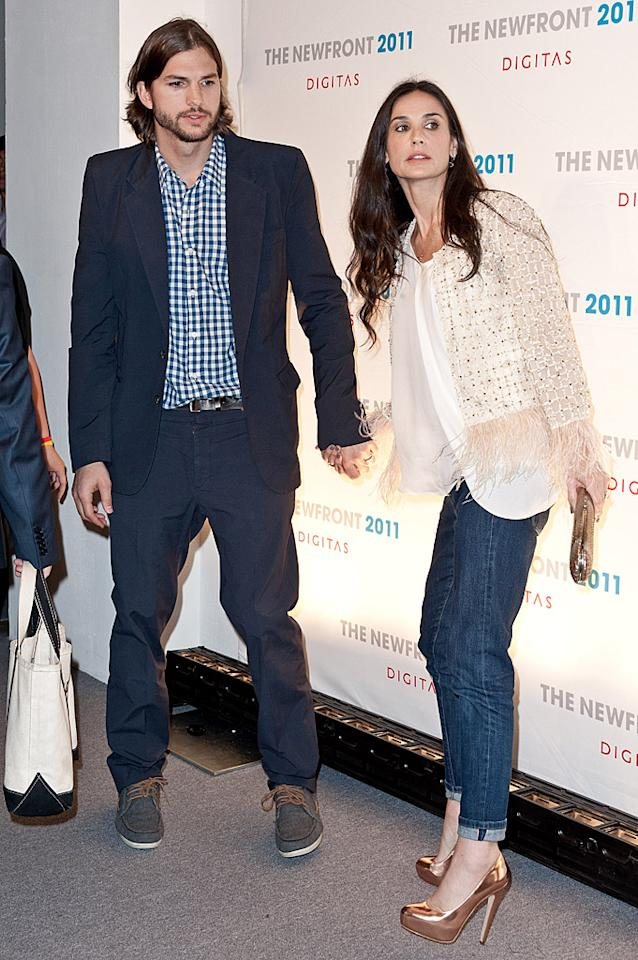 "Demi Moore has ordered her daughters not to mention Ashton Kutcher's name while in her presence,"" reveals <i>Star,</i> which explains she's ""washing 'enablers' out of her life following her rehab stint."" For what her daughters think of the new ban, and whether the actress is secretly still pining for Kutcher, see what a Moore family friend confides to <a target=""_blank"" href=""http://www.gossipcop.com/demi-moore-bans-daughters-ashton-kutcher-name-rule/"">Gossip Cop</a>."