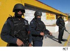 Soldiers or police standing on a street in Juarez