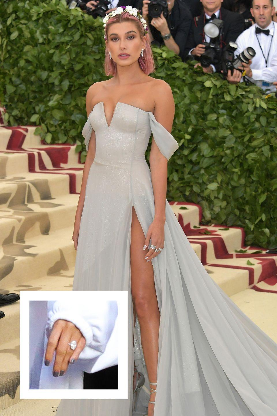 """<p>Justin Bieber and Hailey Baldwin had a whirlwind engagement. Hailey's engagement ring is an oval shaped whopper. The center oval stone is between six and ten carats large, and reportedly cost up to $500,000, <a href=""""https://www.cosmopolitan.com/entertainment/a22137216/hailey-baldwin-engagement-ring-cost-justin-bieber/"""" rel=""""nofollow noopener"""" target=""""_blank"""" data-ylk=""""slk:according to Cosmopolitan."""" class=""""link rapid-noclick-resp"""">according to <em>Cosmopolitan.</em></a></p>"""