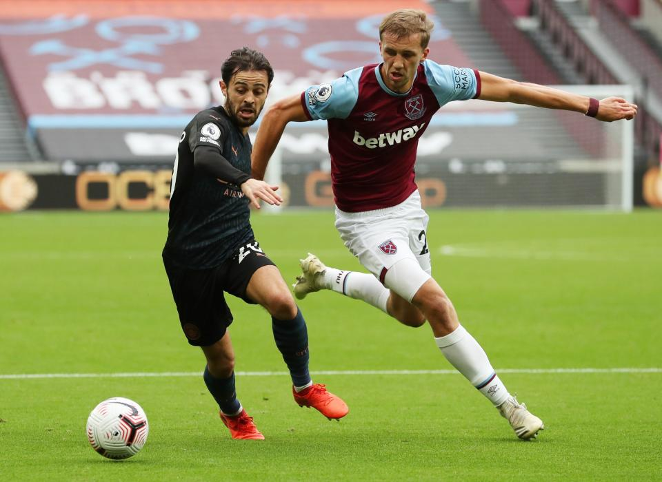 Manchester City's Bernardo Silva (left) in action with West Ham United's Tomas Soucek.