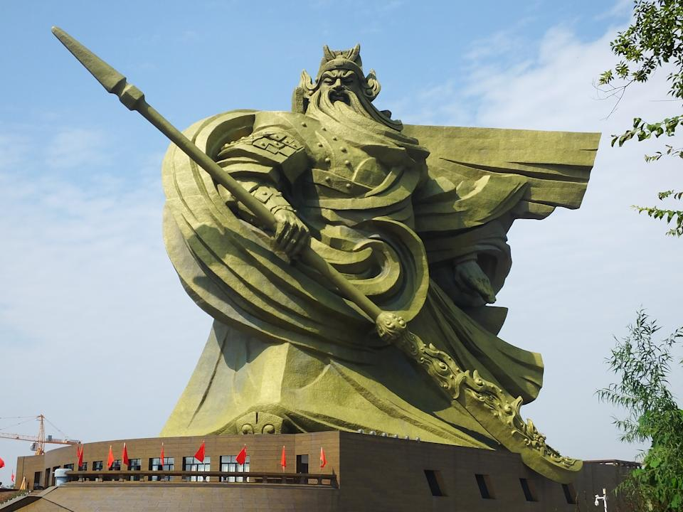 JINGZHOU, CHINA - OCTOBER 09 2020: A view of the 58-meter-tall Guan Gong statue in Jingzhou city in central China's Hubei province Friday, Oct. 09, 2020. The bronze-covered gigantic piece, an artwork by Han Meilin, was completed in 2016. (Photo credit should read Feature China/Barcroft Media via Getty Images)