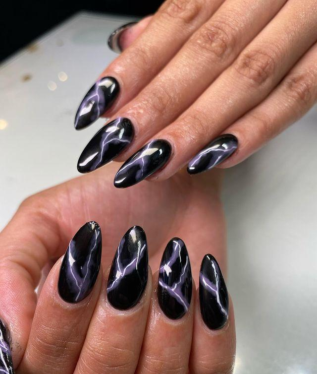 """<p>Nature-inspired nails are always a good idea, but if rainbows and blue skies aren't really your vibe, maybe something a little moodier, like thunderstorms are. These little lightning bolts not only look cool, but they also help to <strong>elongate an <a href=""""https://www.cosmopolitan.com/style-beauty/beauty/g26418551/almond-nails-shape-design/"""" rel=""""nofollow noopener"""" target=""""_blank"""" data-ylk=""""slk:almond nail shape"""" class=""""link rapid-noclick-resp"""">almond nail shape</a></strong> like this one.</p><p><a href=""""https://www.instagram.com/p/CHf4uYsAJjJ/?utm_source=ig_embed&utm_campaign=loading"""" rel=""""nofollow noopener"""" target=""""_blank"""" data-ylk=""""slk:See the original post on Instagram"""" class=""""link rapid-noclick-resp"""">See the original post on Instagram</a></p>"""