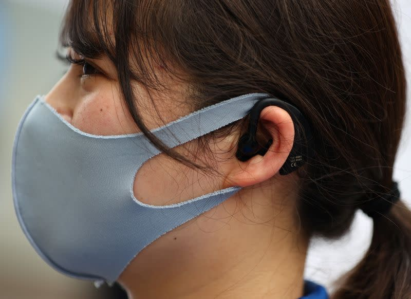 China's Alibaba provides ear-worn device to monitor temperature and heart rate of Olympics staff, in Tokyo