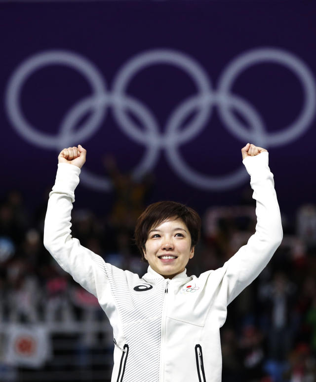 <p>Gold medalist and new Olympic record holder Japan's Nao Kodaira celebrates on the podium after the Women's 500m Speed Skating at the 2018 Winter Olympics on Feb. 18, 2018.<br>(AP Photo/Vadim Ghirda) </p>