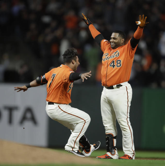 San Francisco Giants' Pablo Sandoval, right, celebrates with Donovan Solano (7) after the team's baseball game against the New York Mets on Friday, July 19, 2019, in San Francisco. The Giants won 1-0 in 10 innings. (AP Photo/Ben Margot)