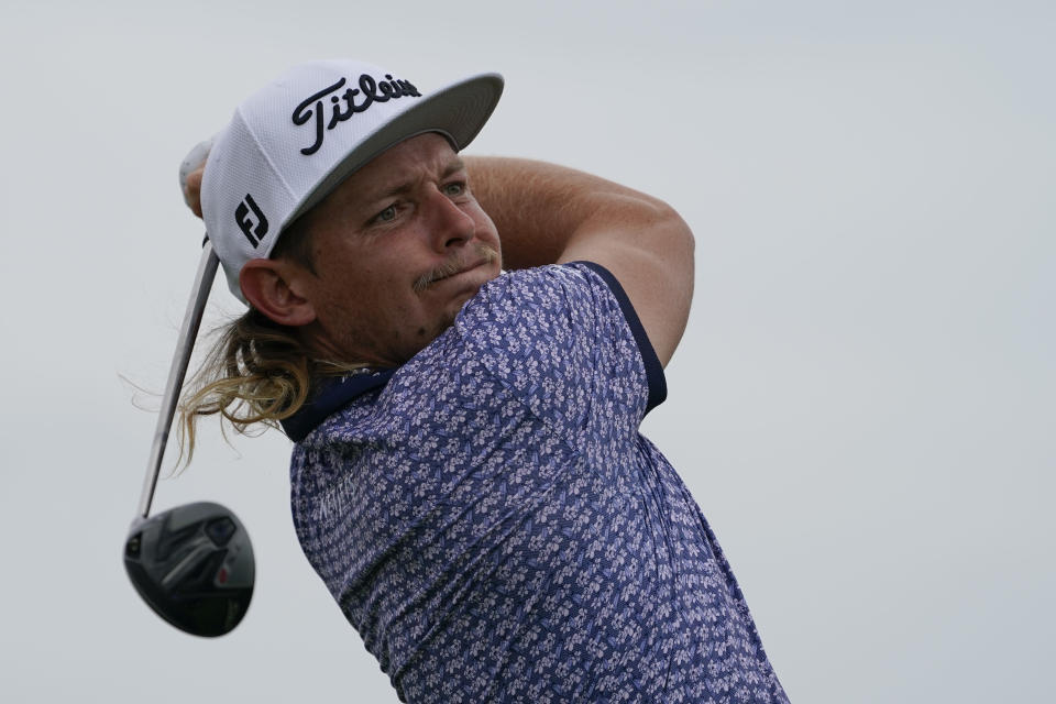 Cameron Smith, of Australia, watches his shot off the third tee in the second round at the Northern Trust golf tournament, Friday, Aug. 20, 2021, at Liberty National Golf Course in Jersey City, N.J. (AP Photo/John Minchillo)