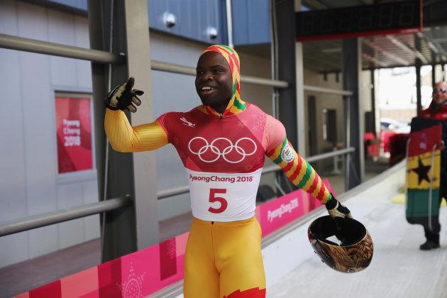 Akwasi Frimpong of Ghana celebrates his run in men's skeleton at PyeongChang