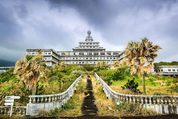 <p>Located on the lush Japanese island of Hachijojima, Hachijo Royal Hotel was once one of the country's largest resorts. The French Baroque architecture juxtaposed against the moss and overgrown trees is eerie. </p>