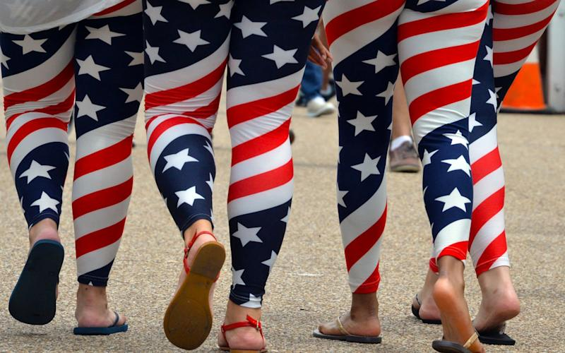 Four young women wear US flag leggings - AFP