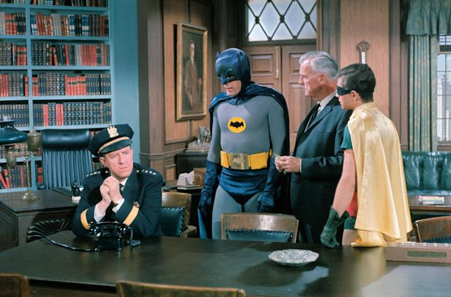 "<p>Left to right: Stafford Repp, Chief of Police; Adam West as Batman; Neil Hamilton as Commissioner and Burt Ward as Robin in a scene from ""The Bookworm"" episode in the ""Batman"" TV series. (Photo: Bettmann/Getty Images) </p>"