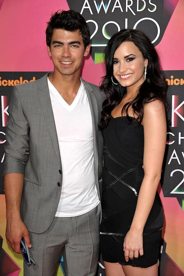 """Ms. Gomez's fellow Disney darling and former BFF Demi Lovato was beaming as she cozied up to her latest beau, Joe Jonas. John Shearer/<a href=""""http://www.wireimage.com"""" target=""""new"""">WireImage.com</a> - March 27, 2010"""