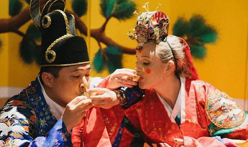 Tony Yoo with his wife in traditional Korean dress on their wedding day. (Image: Tony Yoo)