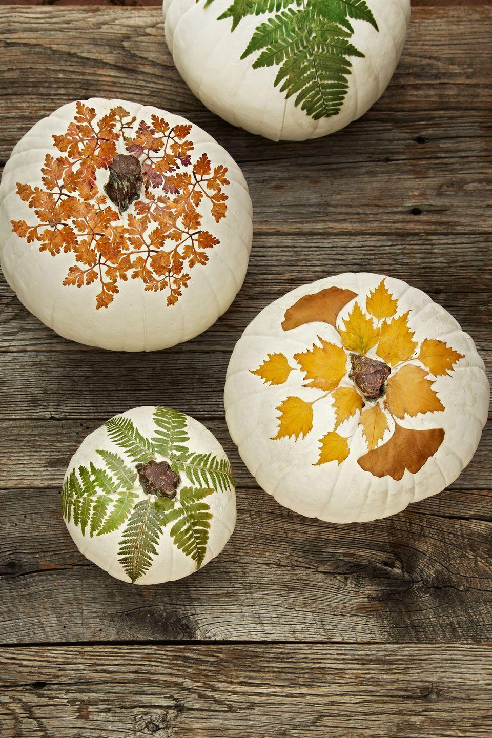 "<p>Put fall leaves to use as a crafting material for fun seasonal DIYs, like these foliage-covered pumpkins.</p><p><strong><a href=""https://www.countryliving.com/home-design/decorating-ideas/advice/g1536/fall-decorating-ideas/?slide=6"" rel=""nofollow noopener"" target=""_blank"" data-ylk=""slk:Get the tutorial"" class=""link rapid-noclick-resp"">Get the tutorial</a>.</strong></p>"