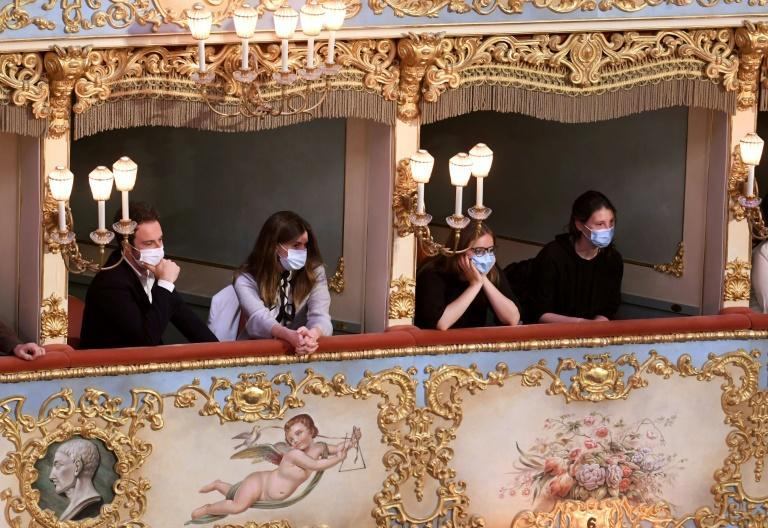 """Spectators attend the performance of """"Verdi e la Fenice"""" (Verdi and the Fenice) at the Fenice Opera theatre to mark its reopening in Venice on April 26, 2021, as bars, restaurants, cinemas and concert halls partially reopen across Italy"""