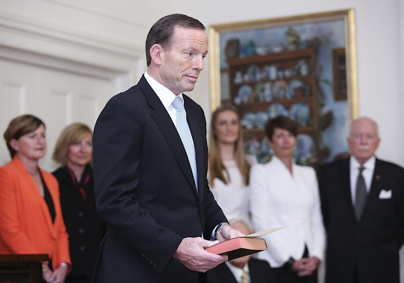 Tony Abbott is sworn in as the 28th prime minister of Australia by Governor General Quentin Bryce at Government House in Canberra, Australia, Wednesday, Sept. 18, 2013. Abbott promised immediate action to slow the stream of asylum seekers arriving by boats from Indonesia and to repeal an unpopular carbon tax levied by the previous administration. (AP Photo/Stefan Postles, Pool)