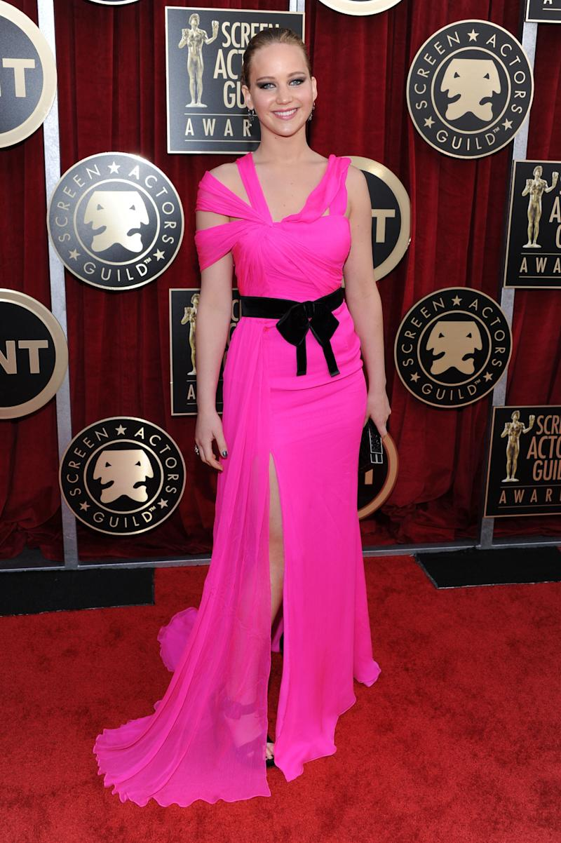 At the 2011 Screen Actor's Guild Awards in Los Angeles, California, Lawrence wowed the crowd as she showed off her figure in a vivid pink Oscar De La Renta gown.