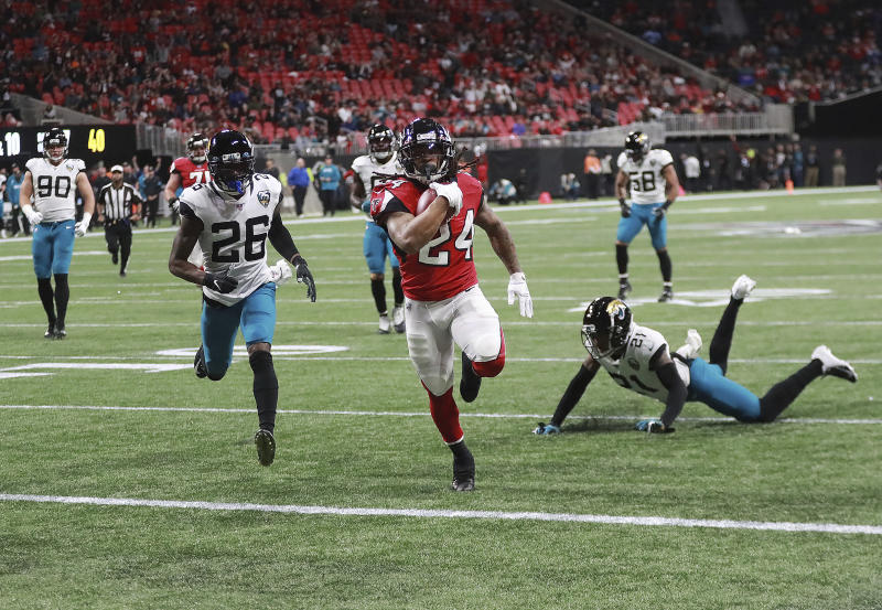 Atlanta Falcons running back Devonta Freeman (24) breaks free for a touchdown run on the opening drive against the Jacksonville Jaguars during the first quarter of an NFL football game Sunday, Dec. 22, 2019, in Atlanta. (Curtis Compton/Atlanta Journal-Constitution via AP)