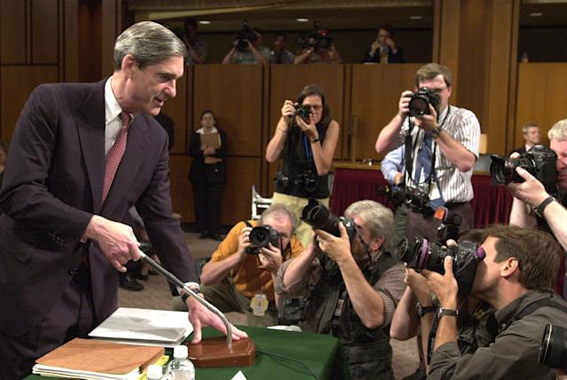 <p>Photographers gather around FBI Director Robert Mueller as he appears before the Senate Judiciary Committee on Capitol Hill Thursday, June 6, 2002. The committee is conducting an oversight hearing on counterterrorism. (Photo: Dennis Cook/AP) </p>