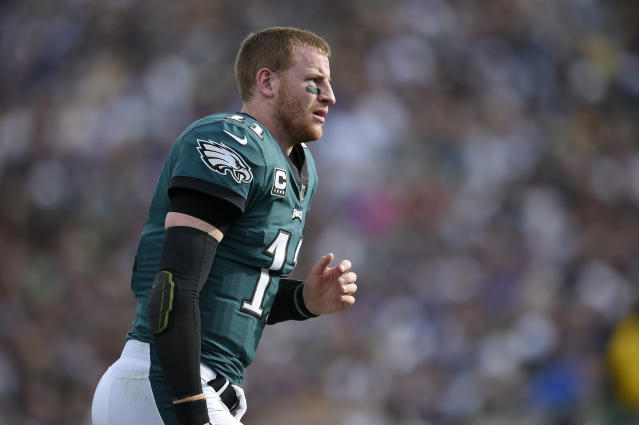Philadelphia Eagles quarterback Carson Wentz defended a social media photo of his dog with birds the pair had hunted. (AP)