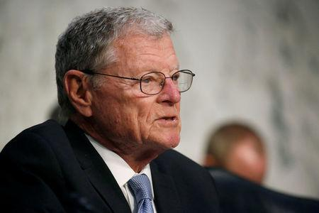 FILE PHOTO: Senator James Inhofe (R-OK) Chairman of the Senate Armed Services Committee questions Director of National Intelligence (DNI) Daniel Coats and Lieutenant General Robert Ashley, director of the Defense Intelligence Agency, during a hearing on Worldwide Threats on Capitol Hill in Washington, U.S., March 6, 2018.      REUTERS/Joshua Roberts