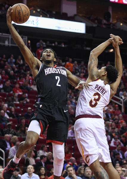 Houston Rockets guard Brandon Knight (2) drives to the basket past Cleveland Cavaliers guard Cameron Payne during the first half of an NBA basketball game Friday, Jan. 11, 2019, in Houston. (AP Photo/Eric Christian Smith)