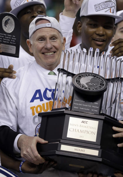 Miami head coach Jim Larranaga holds the trophy after an NCAA college basketball game against North Carolina in the championship of the Atlantic Coast Conference tournament in Greensboro, N.C., Sunday, March 17, 2013. Miami won 87-77. (AP Photo/Gerry Broome)