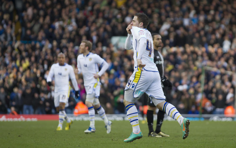 Leeds' Ross McCormack kisses his shirt as he celebrates after scoring against Tottenham during their English FA Cup fourth round soccer match at Elland Road Stadium, Leeds, England, Sunday, Jan. 29, 2013. (AP Photo/Jon Super)