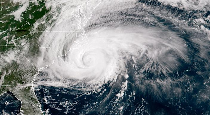 <p>In this NOAA satellite handout image, shows Hurricane Florence it just makes landfall off the coast of the U.S. in the Atlantic Ocean on Sept. 13, 2018. Coastal cities in North Carolina, South Carolina and Virginia are under evacuation orders as the Category 2 hurricane approaches the United States. (Photo: NOAA via Getty Images) </p>