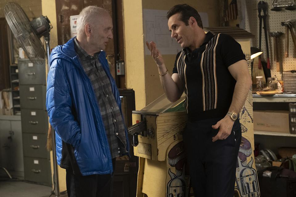 """Creator/writer/producer David Chase and Alessandro Nivola on the set of New Line Cinema and Home Box Office's mob drama """"The Many Saints of Newark,"""" a Warner Bros. Pictures release. (Barry Wetcher/ Warner Bros. Entertainment Inc.)"""