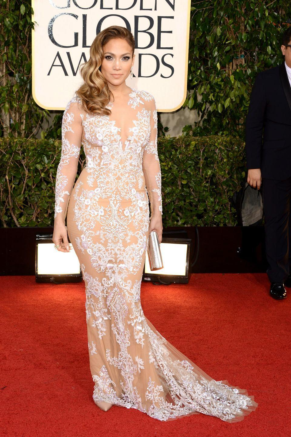 <p>The singer wore a nude sheer gown with a white lace appliqué pattern by Zuhair Murad.</p>