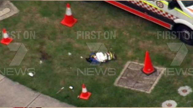 What appears to be blood on the grass outside West Hoxton Hungry Jack's. Photo: 7News
