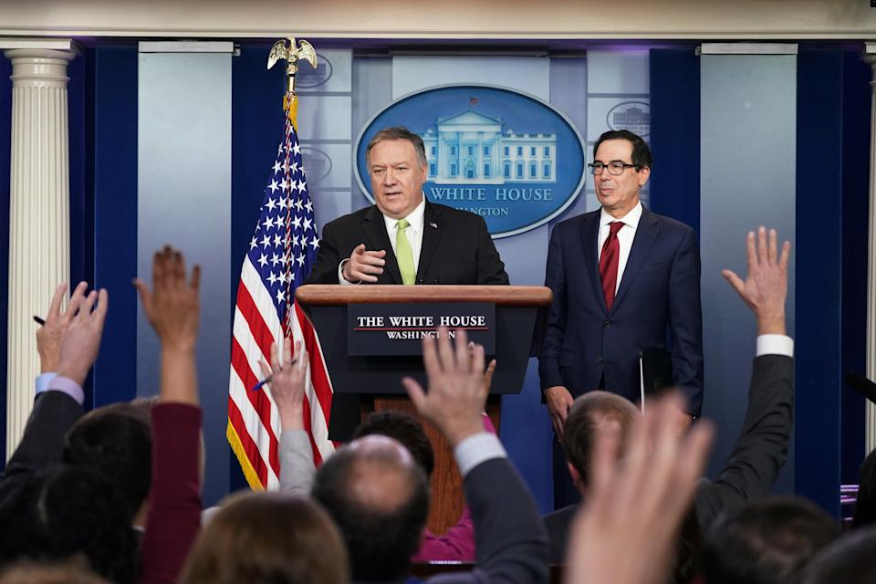 U.S. Secretary of State Mike Pompeo and Treasury Secretary Steven Mnuchin announce new sanctions on Iran in the Brady Press Briefing Room of the White House in Washington, U.S., January 10, 2020. REUTERS/Kevin Lamarque