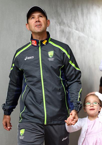 Australian cricket player Ricky Ponting walks with his daughter to attend a press conference to announce his retirement from international cricket on November 29, 2012 in Perth, Australia.  (Photo by Paul Kane/Getty Images)