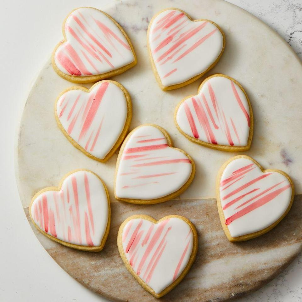 """<p>A little bit of luster dust (an edible powder made for decorating) combined with vodka makes a pretty-in-pink """"paint"""" to decorate these cutest-ever cookies.</p><p><a class=""""link rapid-noclick-resp"""" href=""""https://www.amazon.com/Wilton-2304-115-Nesting-Heart-Cutter/dp/B0000CF4KC?tag=syn-yahoo-20&ascsubtag=%5Bartid%7C10055.g.3182%5Bsrc%7Cyahoo-us"""" rel=""""nofollow noopener"""" target=""""_blank"""" data-ylk=""""slk:SHOP HEART-SHAPED COOKIE CUTTERS"""">SHOP HEART-SHAPED COOKIE CUTTERS</a></p><p><em><a href=""""https://www.goodhousekeeping.com/food-recipes/a34865774/heart-shaped-cookie-recipe/"""" rel=""""nofollow noopener"""" target=""""_blank"""" data-ylk=""""slk:Get the recipe for Heart-Shaped Cookies »"""" class=""""link rapid-noclick-resp"""">Get the recipe for Heart-Shaped Cookies »</a></em></p><p><strong>RELATED: </strong><a href=""""https://www.goodhousekeeping.com/holidays/valentines-day-ideas/g3250/valentines-cookies/"""" rel=""""nofollow noopener"""" target=""""_blank"""" data-ylk=""""slk:42 Valentine's Day Cookies That Make the Perfect Gift"""" class=""""link rapid-noclick-resp"""">42 Valentine's Day Cookies That Make the Perfect Gift</a><br></p>"""
