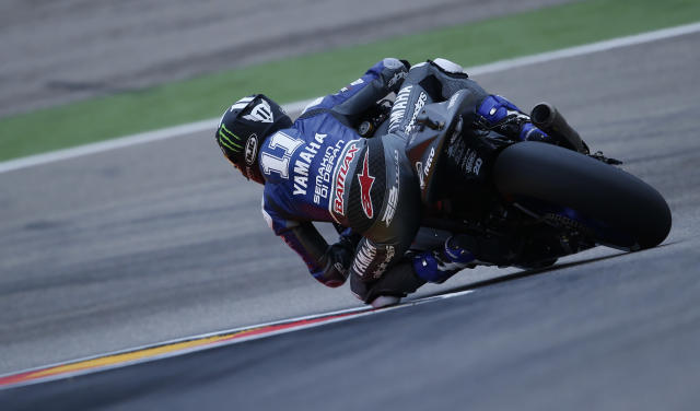Yamaha Factory Racing's US Ben Spies rides during the Moto GP qualifying practice session at Motorland's race track in Alcaniz on September 29, 2012. Yamaha Factory Racing Spanish rider Jorge Lorenzo took the pole, Repsol Honda Team Spanish rider Dani Pedrosa the second position as Monster Yamaha Tech 3 British rider Cal Crutchlow the third position. AFP PHOTO / JOSE JORDANJOSE JORDAN/AFP/GettyImages