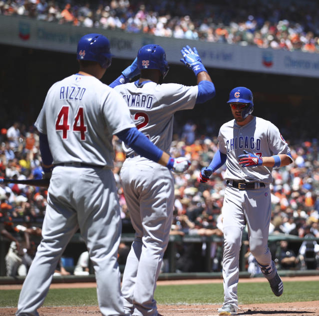 Chicago Cubs' Kris Bryant, right, celebrates with Anthony Rizzo (44) and Jason Heyward (22) after hitting a two-run home run off San Francisco Giants' Johnny Cueto in the fifth inning of a baseball game Wednesday, July 11, 2018, in San Francisco. (AP Photo/Ben Margot)