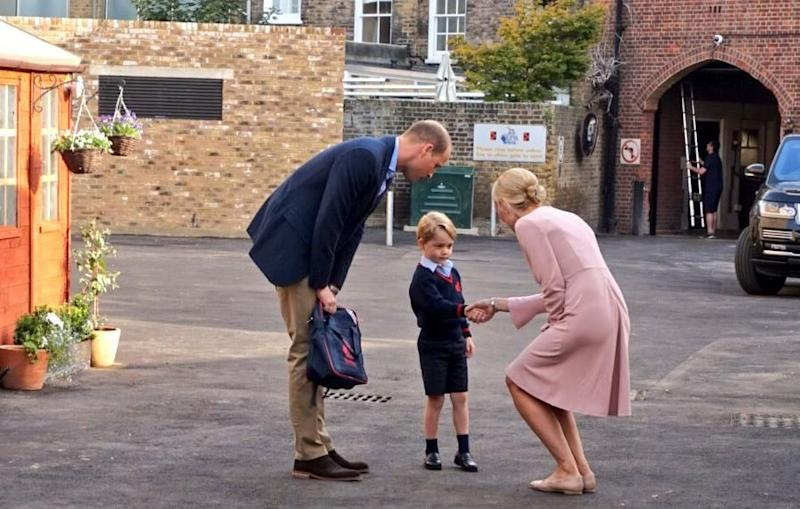 Prince George looked nervous as he entered the school with his father Prince William. Source: Kensington Palace