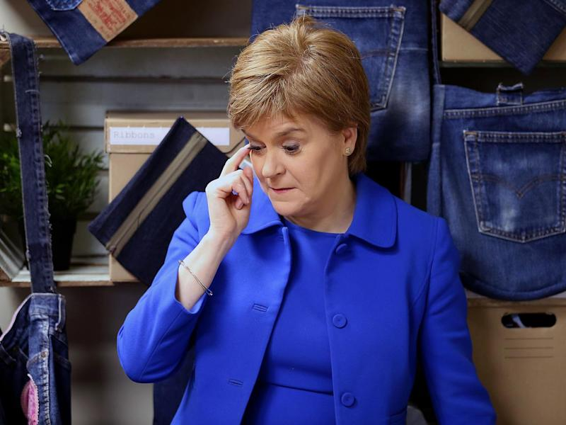 First Minister Nicola Sturgeon during a visit to R:evolve Clothing, an upcycling workshop in Rutherglen, before making an announcement on the Climate Challenge Fund (PA wire)