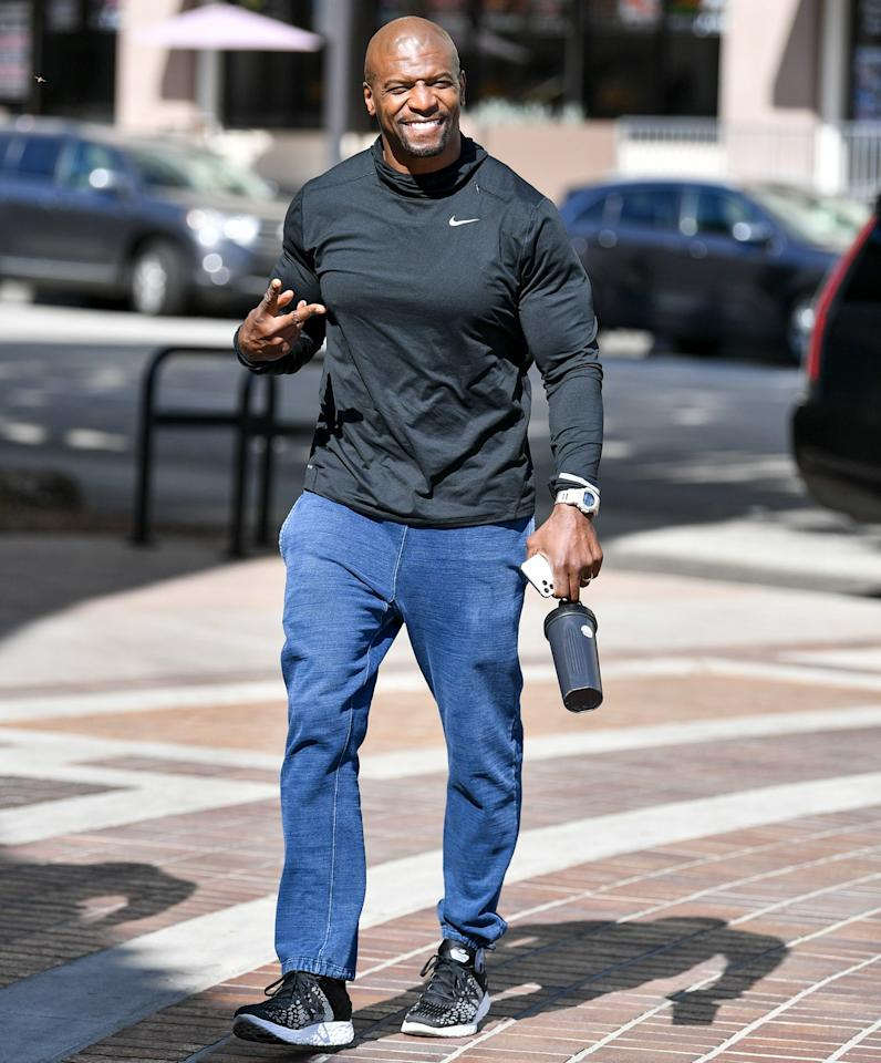 A casual Terry Crews keeps it moving in L.A. on Friday.