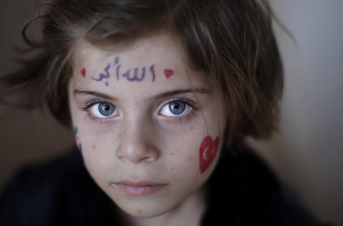 A Syrian girl, Aya Abdulhay, 5, who fled her home in Aleppo with her family due to fighting between the Syrian army and the rebels, takes refuge at the Bab Al-Salameh border crossing, in hopes of entering one of the refugee camps in Turkey, near the Syrian town of Azaz, Friday, Aug. 31, 2012. (AP Photo/Muhammed Muheisen)