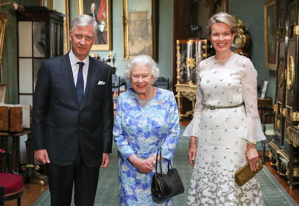 The Queen wore the the Sapphire Jubilee Snowflake Brooch to meet the King and Queen of Belgium [Photo: PA]