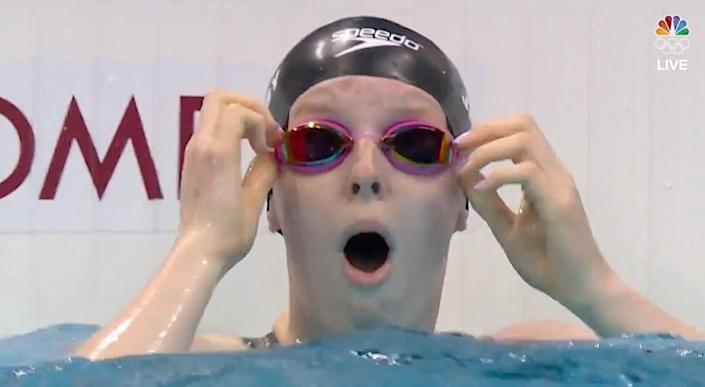Lydia Jacoby looks shocked at winning the 100-meter breaststroke at the Tokyo  Olympics.