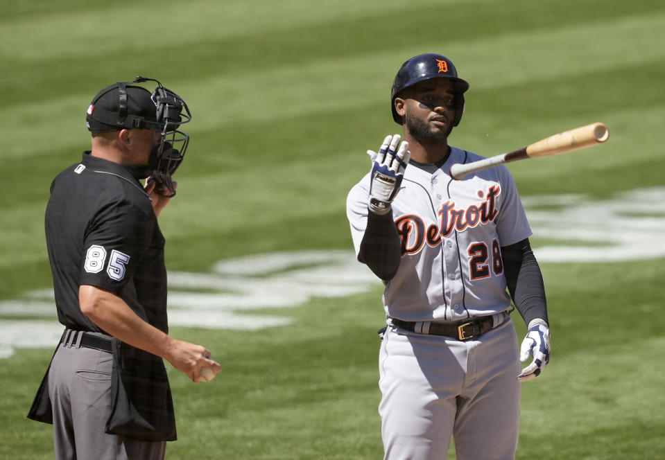 Detroit Tigers' Niko Goodrum (28) throws his bat as he is called out by umpire Stu Scheurwater (85) during the fifth inning against the Oakland Athletics in a baseball game on Saturday, April 17, 2021, in Oakland, Calif. (AP Photo/Tony Avelar)