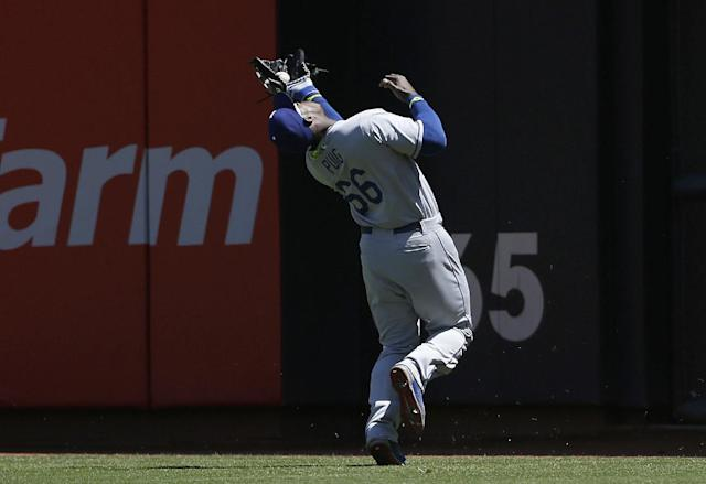Los Angeles Dodgers right fielder Yasiel Puig catches a fly ball hit by San Francisco Giants' Gregor Blanco during the second inning of a baseball game in San Francisco, Thursday, April 17, 2014. (AP Photo/Jeff Chiu)
