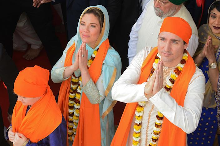 Canadian Prime Minister Justin Trudeau and wife Sophie Gregoire pay their respects at the SSikh Golden Temple in Amritsar on Feb. 21, 2018. | Narinder Nanu—AFP/Getty Images
