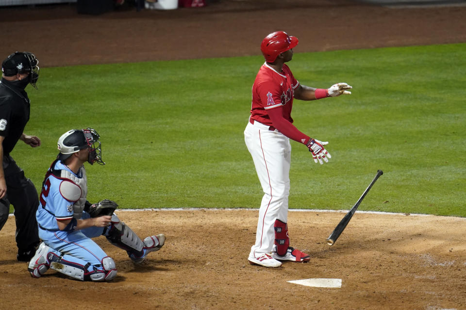 Los Angeles Angels' Justin Upton watches the flight of his grand slam home run during the seventh inning of a baseball game against the Minnesota Twins Friday, April 16, 2021, in Anaheim, Calif. (AP Photo/Marcio Jose Sanchez)